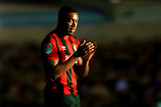 Bournemouth midfielder Jordon Ibe applauds the travelling fans as the flood lights go out for the third time during the EFL Cup match between Burton Albion and Bournemouth at the Pirelli Stadium, Burton upon Trent, England on 25 September 2019.