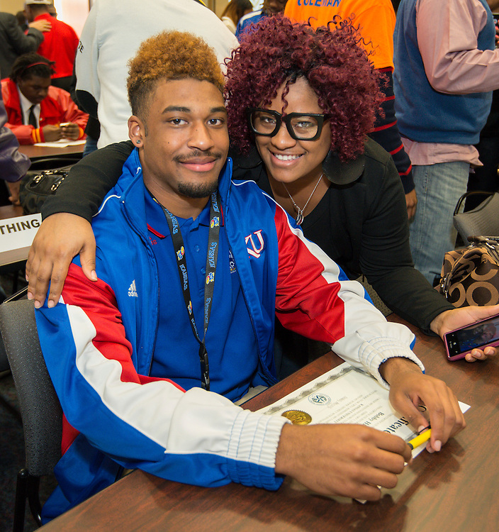 Westside's Bobby Hartzog (Kansas) poses for a photograph with his sister during a National Signing Day ceremony at the Region 4 Education Center, February 5, 2014.