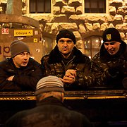 December 18, 2013 - Kiev, Ukraine: Pro-EU demonstrators listen to a man playing the piano at Independence Square.<br /> On the night of 21 November 2013, a wave of demonstrations and civil unrest began in Ukraine, when spontaneous protests erupted in the capital of Kiev as a response to the government&rsquo;s suspension of the preparations for signing an association and free trade agreement with the European Union. Anti-government protesters occupied Independence Square, also known as Maidan, demanding the resignation of President Viktor Yanukovych and accusing him of refusing the planned trade and political pact with the EU in favor of closer ties with Russia.<br /> After a days of demonstrations, an increasing number of people joined the protests. As a responses to a police crackdown on November 30, half a million people took the square. The protests are ongoing despite a heavy police presence in the city, regular sub-zero temperatures, and snow. (Paulo Nunes dos Santos/Polaris)