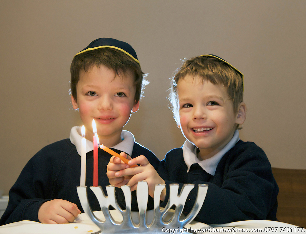 Twins YONI & GABI ALTWARG-PEEL lighting their chanukiah.  Next year they will be in Modi'in where chanukah originated.