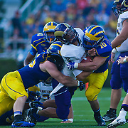 West chester quarterback Matt Carroll #12 get hit by Delaware Linebacker Paul Worrilow #10 and Delaware Defensive tackle Ethan Clark #95 during a Week 2 NCAA football game against Westchester in the first quarter.  ..#8 Delaware defeated Westchester 28-17  in their home opener at Delaware Stadium Saturday Sept. 10, 2011 in Newark DE...Delaware will return home Sept. 17, 2011 for a showdown with interstate Rival Delaware State at 6:pm at Delaware Stadium. (Monsterphoto/Saquan Stimpson)