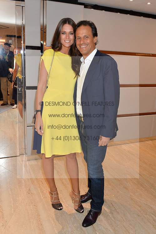 ARUN & KIM NAYAR at a dinner hosted by Tod's to celebrate the refurbishment of their store 2-5 Old Bond Street, London on 15th September 2016.