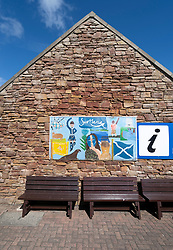 Posters and benches at John O'Groats in Cathness on  the North Coast 500 scenic driving route in northern Scotland, UK