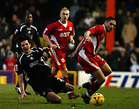 Photo: Ed Godden.<br />Bristol City v Swansea. Coca Cola League 1. 28/01/2006.<br />Swansea's Bradley Orr (R) brings down Rory Fallon.