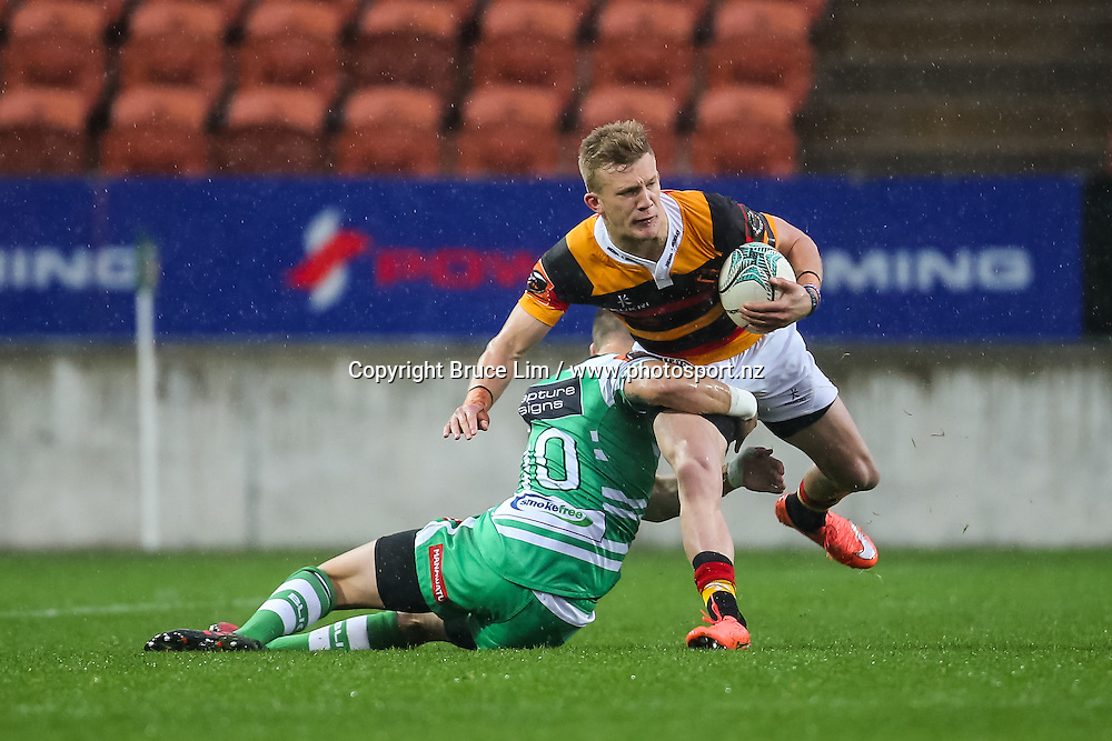 Waikato fullback Damian McKenzie looks to break the tackle of Manawatu first five Otere Black during round 3 of the Mitre 10 Cup rugby union national provincial championship - Waikato v Manawatu played at FMG Stadium Waikato, Hamilton, New Zealand on Sunday 4 September 2016.  <br /> <br /> Copyright Photo: Bruce Lim / www.photosport.nz