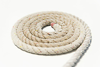 Coiled rope on yacht deck