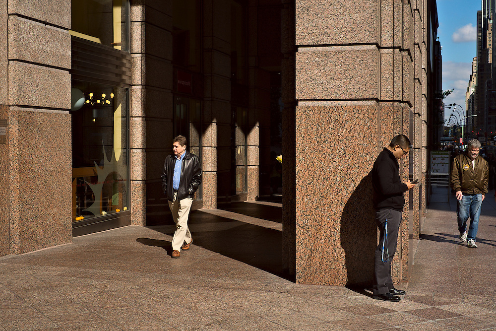 Three men on sidewalk