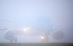 © Licensed to London News Pictures. 18/12/2019. Leeds UK. A aircraft is only just visible as it prepares to take off in thick fog at Leeds Bradford airport this morning. Photo credit: Andrew McCaren/LNP