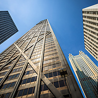John Hancock Skyscraper in Chicago low angle view with other Chicago buildings. The John Hancock Building is one of the tallest skyscrapers in Chicago and also the United States. Photo is wide angle and high resolution.
