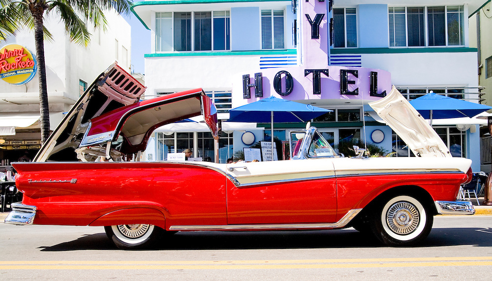 A rare, 1957 Ford Skyliner hardtop convertible with its top half-folded during Art Deco Weekend, an annual January festival on Miami Beach's Ocean Drive.<br />