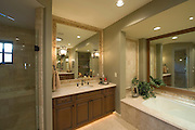 Bathroom with square mirror in Palm Springs home