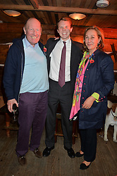 Left to right, JACK BROOKSBANK, his father GEORGE BROOKSBANK and GILLY NORTON founder of Skiing With Heroes at Skiing With Heroes Junior Committee Awareness Party held at Bodo's Schloss, 2A Kensington High Street, London on 6th November 2014.