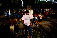 Guatemala La Democracia, A man rests up against a tree in the late afternoon light as he waits for Presidential Candidate, Otto Perez Molina, of the Patriotic Party to arrive at a rally in La Democracia Guatemala, Thursday Sept 6, 2007.  (photo by/ Darren Hauck)........