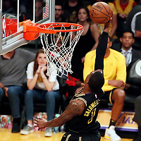 30 March 2018: Los Angeles Lakers guard Kentavious Caldwell-Pope (1) goes for the dunk during the Milwaukee Bucks 124-122 victory over the LA Lakers, at the Staples Center, Los Angeles, California, USA.