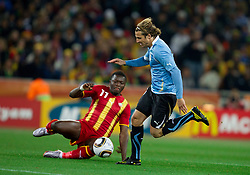 Sulley Muntari of Ghana vs Diego Forlan of Uruguay  during to the 2010 FIFA World Cup South Africa Quarter Finals football match between Uruguay and Ghana on July 02, 2010 at Soccer City Stadium in Sowetto, suburb of Johannesburg. (Photo by Vid Ponikvar / Sportida)
