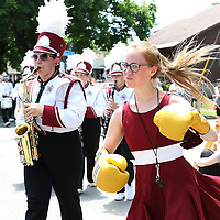 CANASTOTA, NY - JUNE 14: A high school cheerleader runs around with a set of boxing gloves during the parade at the International Boxing Hall of Fame induction Weekend of Champions events on June 14, 2015 in Canastota, New York. (Photo by Alex Menendez/Getty Images) *** Local Caption ***