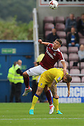 Northampton Town striker Alex Revell (10) jumps AFC Wimbledon defender & captain Barry Fuller (2) during the EFL Sky Bet League 1 match between Northampton Town and AFC Wimbledon at Sixfields Stadium, Northampton, England on 20 August 2016. Photo by Stuart Butcher.
