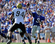 Oct 11, 2008; Lawrence, KS, USA; Kansas Jayhawks quarterback Todd Reesing (5) throws the ball down field against pressure from Colorado Buffaloes defensive tackle (94) during the second quarter at Memorial Stadium.  Kansas won 30-14.