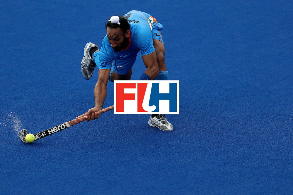 RIO DE JANEIRO, BRAZIL - AUGUST 08:  Sardar Singh #8 of India passes the ball against Germany during a Men's Pool B match on Day 3 of the Rio 2016 Olympic Games at the Olympic Hockey Centre on August 8, 2016 in Rio de Janeiro, Brazil.  (Photo by Sean M. Haffey/Getty Images)