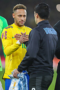 Brazil forward Neymar Jr (10) shakes hands with Uruguay forward Luis Suárez (9) during the Friendly International match between Brazil and Uruguay at the Emirates Stadium, London, England on 16 November 2018.