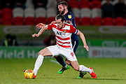 Southend United defender John White (48) fouls Doncaster Rovers forward John Marquis (9)  during the EFL Sky Bet League 1 match between Doncaster Rovers and Southend United at the Keepmoat Stadium, Doncaster, England on 12 February 2019.