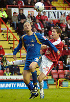 Photo: Ed Godden.<br />Bristol City v Doncaster Rovers. Coca Cola League 1. 28/10/2006. Doncaster's Stephen Roberts (L), stops Barry Corr from entering the Doncaster area.