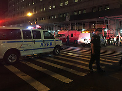 NEW YORK, Sept. 18, 2016 (Xinhua) -- This cellphone photo taken on Sept. 17, 2016 shows the police blocking a road after an explosion in New York, the United States. A total of 25 people have been injured in an explosion in the Chelsea neighborhood of Manhattan on Saturday evening, and the cause of the blast is under investigation, the New York City Fire Department said. (Xinhua/Li Muzi) (yy) (Credit Image: © Li Muzi/Xinhua via ZUMA Wire)