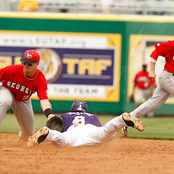 Apr 04, 2010; Baton Rouge, LA, USA; LSU Tigers Mikie Mahtook (8) slides safely into second base as the ball gets away from Georgia Bulldogs short stop Levi Hyams (3) on a steal during a game at Alex Box Stadium. Mandatory Credit: Derick E. Hingle-US PRESSWIRE
