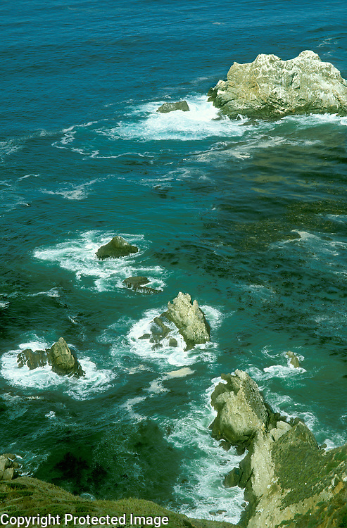 Waves breaking on rocks on California coast in Big Sur region between Monterey and San Luis Obispo.