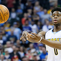 06 March 2016: Denver Nuggets guard Emmanuel Mudiay (0) passes the ball during the Denver Nuggets 116-114 overtime victory over the Dallas Mavericks, at the Pepsi Center, Denver, Colorado, USA.