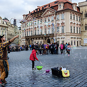A busker unleashes a cascade of bubbles in the old town square at the heart of Prague, capital of the Czech Republic, on 10 November 2014.