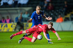 SWANSEA, ENGLAND - Friday, September 4, 2009: Wales' Simon Church is brought down by Italy's Giuseppe Bellusci but no penalty is given during the UEFA Under 21 Championship Qualifying Group 3 match at the Liberty Stadium. (Photo by David Rawcliffe/Propaganda)