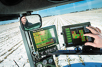 Farmer David Nelson looks over the computers and software that he uses in the cab of his tractor to plan and implement his corn and soybean  plantings on his farm near Fort Dodge, Iowa, on February, 18, 2014.