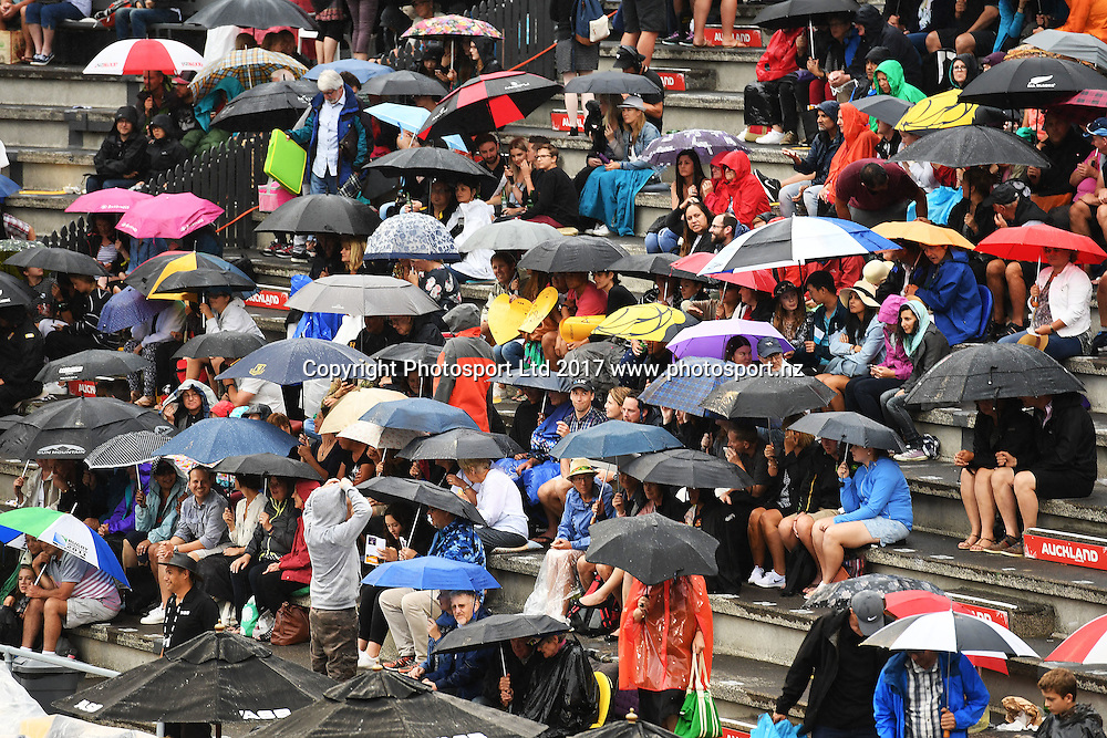 Tennis fans in the rain at the ASB Classic. WTA Womens Tournament. ASB Tennis Centre, Auckland, New Zealand. Tuesday 3 January 2017. © Copyright photo: Andrew Cornaga / www.photosport.nz