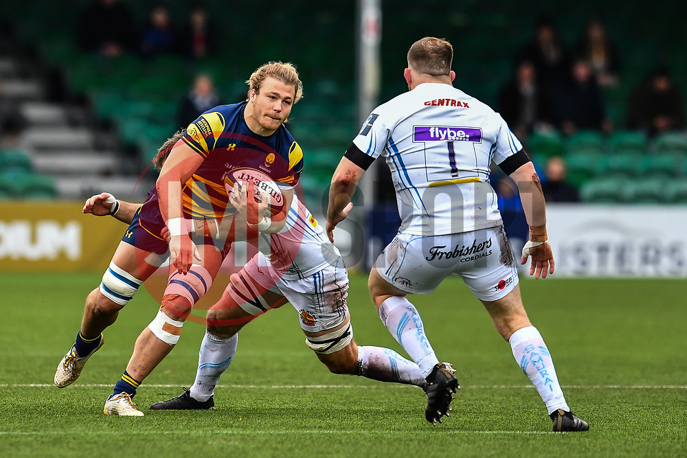 David Denton of Worcester Warriors is tackled byOllie Atkins of Exeter Chiefs - Mandatory by-line: Craig Thomas/JMP - 27/01/2018 - RUGBY - Sixways Stadium - Worcester, England - Worcester Warriors v Exeter Chiefs - Anglo Welsh Cup