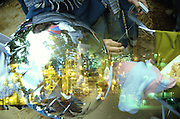 Abstract double exposure of mylar ballon on baby stroller permeated by Benecia oil refinery.