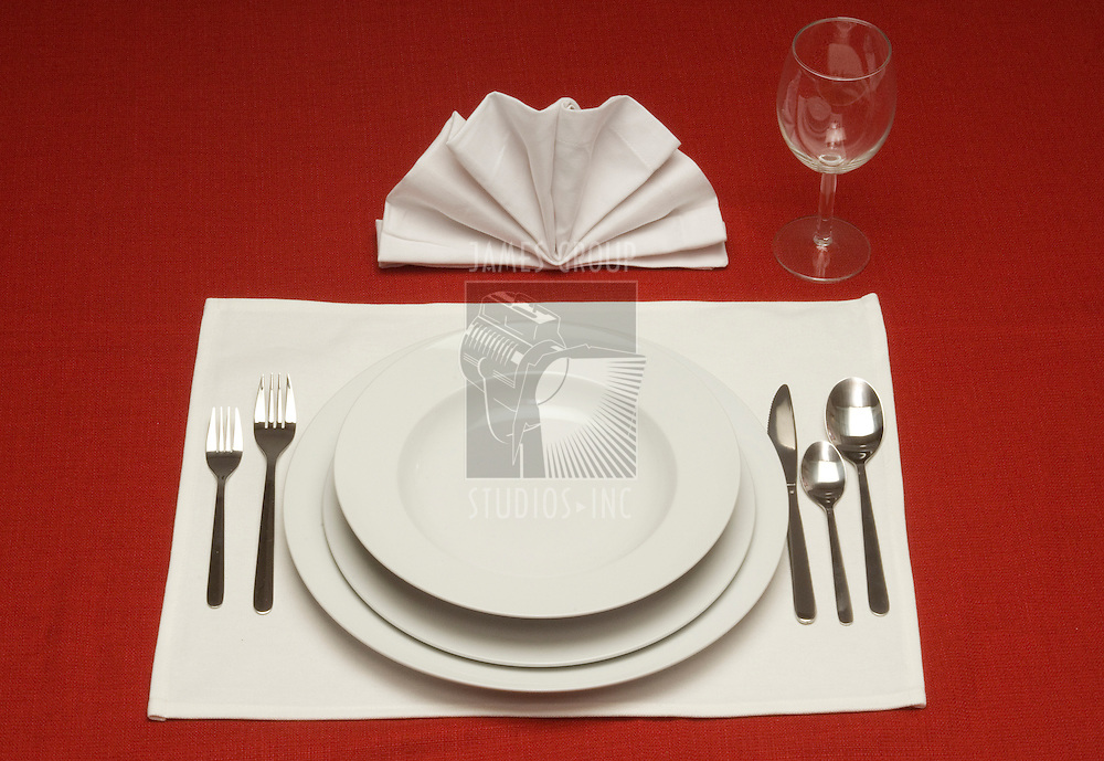 Red tablecloth with a place setting for one