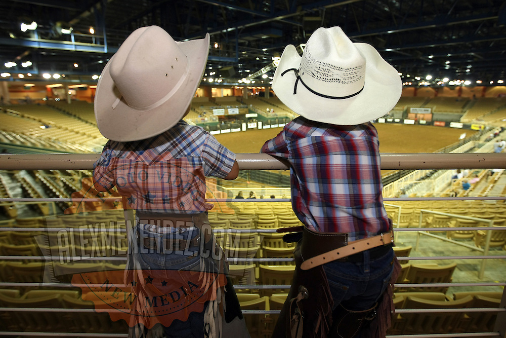 Two young cowboys watch as the arena is prepared prior to the 129th performance of the PRCA Silver Spurs Rodeo at the Silver Spurs Arena   on Friday, June 1, 2012 in Kissimmee, Florida. (AP Photo/Alex Menendez) Silver Spurs rodeo action in Kissimee, Florida. PRCA rodeo event in Florida. The 129th annual running of the cowboy event.