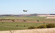 Boeing Chinook helicopter flying over military training area, Upavon Down, Salisbury Plain, Wiltshire, England, UK