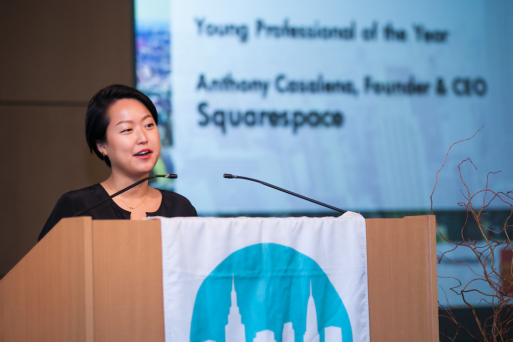 Seine Kim, accepted on behalf of Anthony Casalena for Squarespace, the 2014 Young Professionals of the Year awardee. Celebrating the business leaders in New York City, who have built outstanding businesses - contributing to the economy and community as well. The MCC Business Awards Breakfast is the Manhattan Chamber's premiere event adn was attended by over 250 entrepreneurs, business owners, executives and legislative leaders in New York City. (Photo: www.JeffreyHolmes.com)