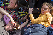 Campaigners locked and glues to a yacht in the middle of the occupied Oxford Circus on day 4 of protests by climate change environmental activists with pressure group Extinction Rebellion, on18th April 2019, in London, England.