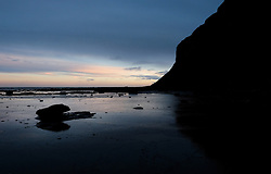 © Licensed to London News Pictures. 08/01/16<br /> Saltburn, UK. <br /> <br /> Rocks are exposed at low tide as day breaks over Saltburn beach. <br /> <br /> Photo credit : Ian Forsyth/LNP