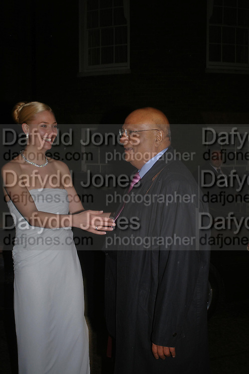 Bride,  Michelle Bonn and  Lord  Paul, Lord and Lady Paul. Wedding reception of Angad Paul and Michelle Bonn, Lancaster House. St. James. 21 March 2005. ONE TIME USE ONLY - DO NOT ARCHIVE  © Copyright Photograph by Dafydd Jones 66 Stockwell Park Rd. London SW9 0DA Tel 020 7733 0108 www.dafjones.com