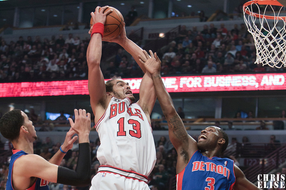 30 October 2010: Chicago Bulls Joakim Noah grabs an offensive rebound over Detroit Pistons Rodney Stuckey during the Chicago Bulls 101-91 victory over the Detroit Pistons at the United Center, in Chicago, Illinois, USA.