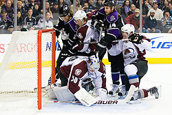 Brian Elliott (Colorado Avalanche, #30) covers a puck during ice-hockey match between Los Angeles Kings and Colorado Avalanche in NHL league, Februar 26, 2011 at Staples Center, Los Angeles, USA. (Photo By Matic Klansek Velej / Sportida.com)