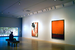 """Dallas Museum of Art: A comfortable bench awaits visitors in the Contemporary Art Galleries, the better to view an untitled oil painting by Clyfford Still (left) and """"Orange, Red and Red"""" painted by Mark Rothko in 1962."""