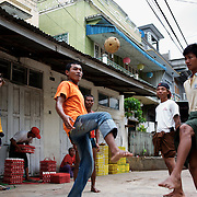 May 15, 2013 - Meiktila, Myanmar: Teenagers play chinlone, a sort of foot volley with a wicker ball in Meiktila, a city in central Myanmar that in recent month has been stage for anti-Muslim violence. CREDIT: Paulo Nunes dos Santos