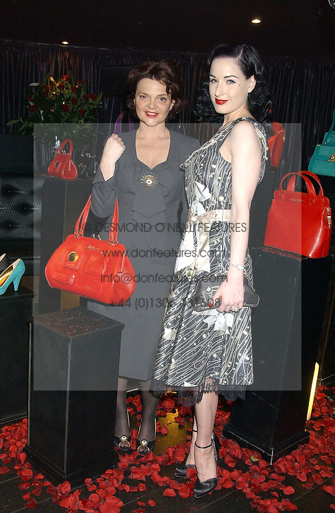 Left to right, LULU GUINNESS and DITA VON TEESE at a preview of Lulu Guinness's new Handbag Collection ' Couture' held at Aviva, Baglioni Hotel, 60 Hyde Park Gate, London SW7 on 15th February 2006.<br />