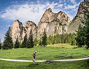 Vallunga/Langental valley, Puez-Geisler Nature Park, Val Gardena, Dolomites, South Tyrol, Italy, Europe. The beautiful ski resort of Selva di Val Gardena (German: Wolkenstein in Gröden; Ladin: Sëlva Gherdëine) makes a great hiking base in the Dolomites, in the South Tyrol region (Trentino-Alto Adige/Südtirol). For our favorite hike in the Dolomiti, start from Selva with the first morning bus to Ortisei, take the Seceda lift, admire great views up at the cross on the edge of Val di Funes (Villnöss), then walk 12 miles (2000 feet up, 5000 feet down) via the steep pass Furcela Forces De Sieles (Forcella Forces de Sielles) to beautiful Vallunga (trail #2 to 16), finishing where you started in Selva. The hike traverses the Geisler/Odle and Puez Groups from verdant pastures to alpine wonders, all preserved in a vast Nature Park: Parco Naturale Puez-Odle (German: Naturpark Puez-Geisler; Ladin: Parch Natural Pöz-Odles). UNESCO honored the Dolomites as a natural World Heritage Site in 2009. This panorama was stitched from 3 overlapping photos.