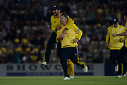 Rilee Rossouw and Colin Munro of Hampshire celebrate the wicket of Dwayne Bravo during the Vitality T20 Blast South Group match between Hampshire County Cricket Club and Middlesex County Cricket Club at the Ageas Bowl, Southampton, United Kingdom on 20 July 2018. Picture by Dave Vokes.